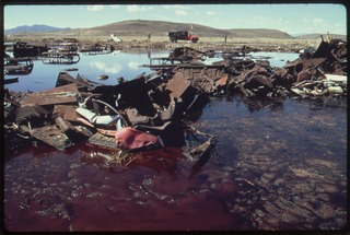 lossy-page1-320px-ACID_WATER_OIL_AND_ACID_CLAY_SLUDGE_ARE_EVIDENT_IN_THIS_FIVE_ACRE_POND_ALSO_CLUTTERED_WITH_JUNKED_CARS_AND_OTHER..._-_NARA_-_555852